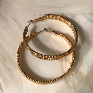 Traci-Lynn gold tone thick hoop textured earring